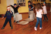 children playing musical chairs; old fashioned parlour games