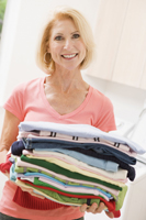 woman holding laundry; clothing drive; mom with laundry