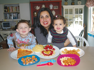 Anila Nitekman, inventor of the Tiny Bites Food Shears, with children