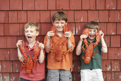 kids holding lobsters; little boys playing with Lobsters; Memorial Day cookout