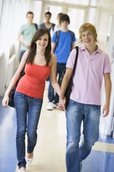teen sweethearts; teen girl and boy holding hands; talking sex with kids