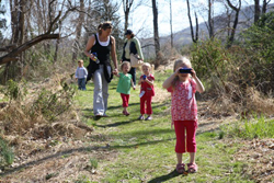 Hudson Highlands Nature Museum Outdoor Discovery Center; family on a nature walk in woods; nature hike with kids