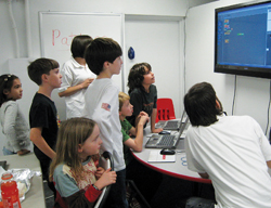 Launch Math Achievement Center, NYC; kids learning about math; kids learning on a computer