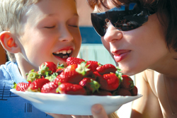 Nassau County Strawberry Festival; woman and boy eating strawberries; fresh strawberries; mother and son