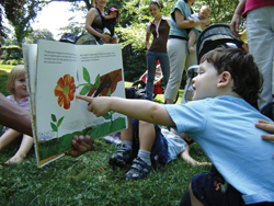 storytelling circle; child pointing at story book