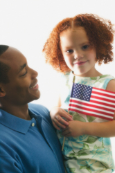 young girl holding american flag; fourth of july; family; father and daughter
