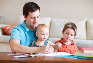 dad with children; father with two young children, drawing, at home