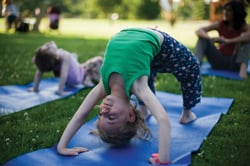 little girl doing yoga; family yoga; child in Upward Bow pose