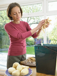 woman composting; compost
