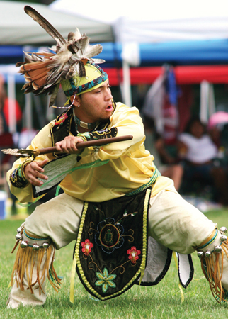 native american dancer in traditional clothing