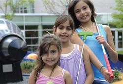 three young girls playing miniature golf; Rocket Park Mini Golf Course at NY Hall of Science