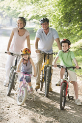 family riding bikes; family bicycle race