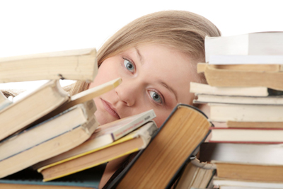 young girl, student surrounded by books