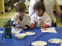 kids painting; smocks; young children in art class