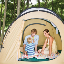 family camping in the woods; in a tent