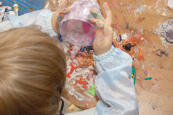 child painting; little boy finger painting; making a mess with paint