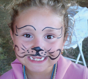 face painting; child with face painted like a cat