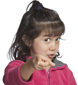 etiquette expert; little girl pointing finger; young girl as authoritative figure