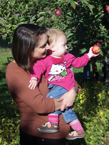 mom and daughter picking apples in an apple orchard; Orchards of Concklin apple picking