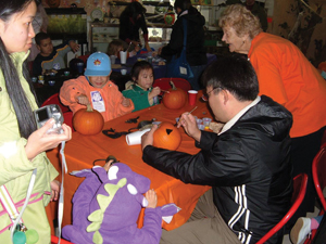 kids painting pumpkins on Halloween; Queens Botanical Garden