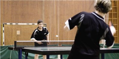 ping pong tournament; teens playing table tennis