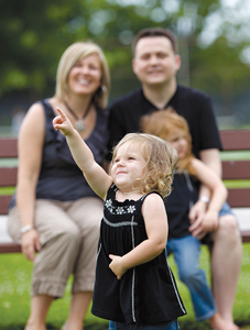 autistic child with family; young girl with special needs