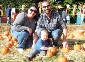 family in pumpkin patch; picking pumpkins; mill neck fall harvest festival