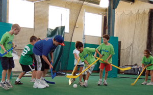 Vision Sports Club, sports zone birthday parties; kids playing floor hockey