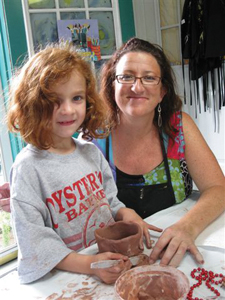 The Garden Art Studio in Mineola, NY; little girl doing arts and crafts; clay making class