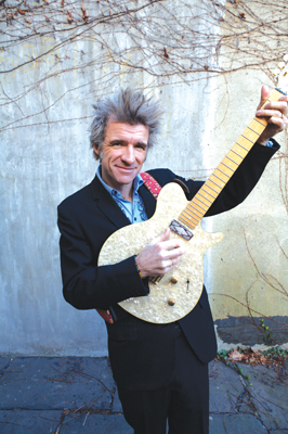 Dan Zanes playing the guitar; Dan Zanes concert in Brooklyn