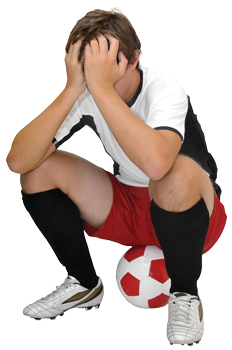 boy soccer player, upset after losing a game
