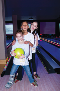 young girls bowling; Strike Out Pediatric Cancer Bowl-A-Thon