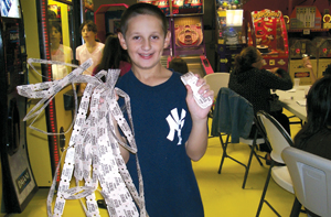 The Sports Place; boy holding tickets he won in the arcade