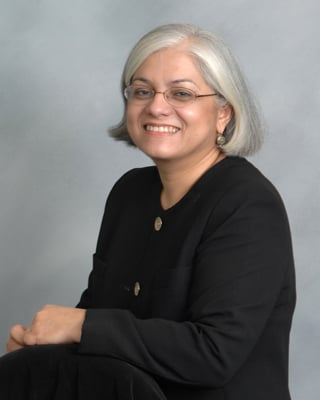 Dr. Yvette Caro, director of the Queens College Psychological Center