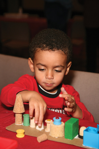 child making festive craft; Kwanzaa celebration