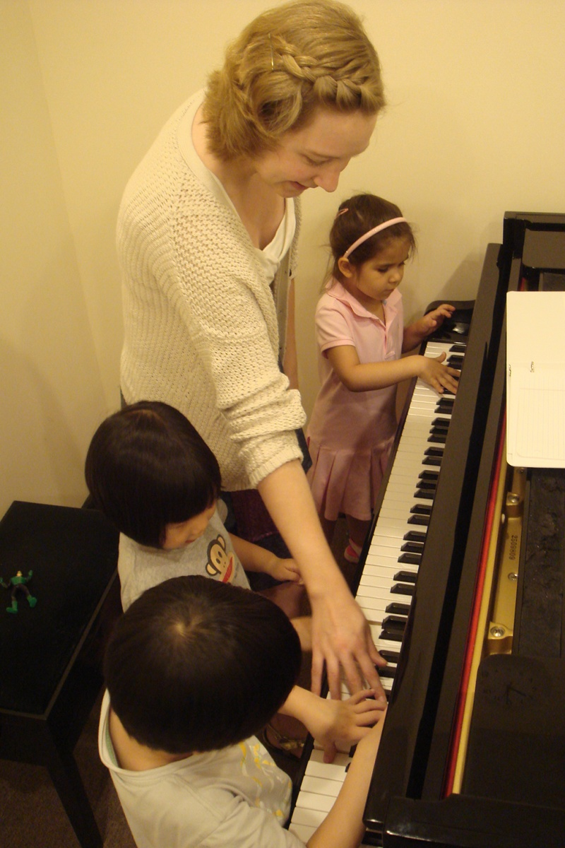 vienna music teacher at piano with kids