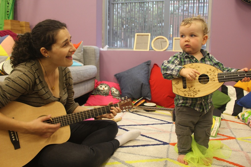 child and teacher playing with instruments