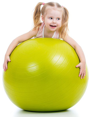 child on stability exercise ball