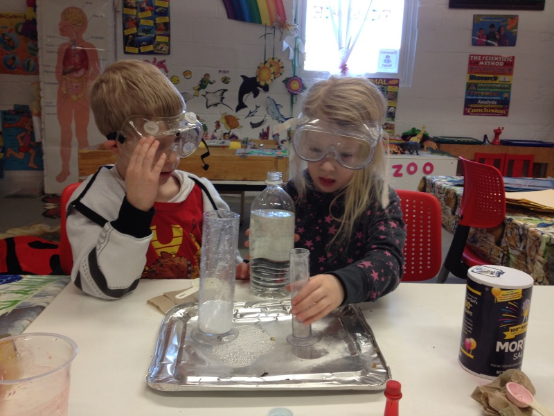 children doing science experiment