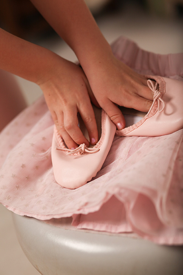 hands with ballet slippers