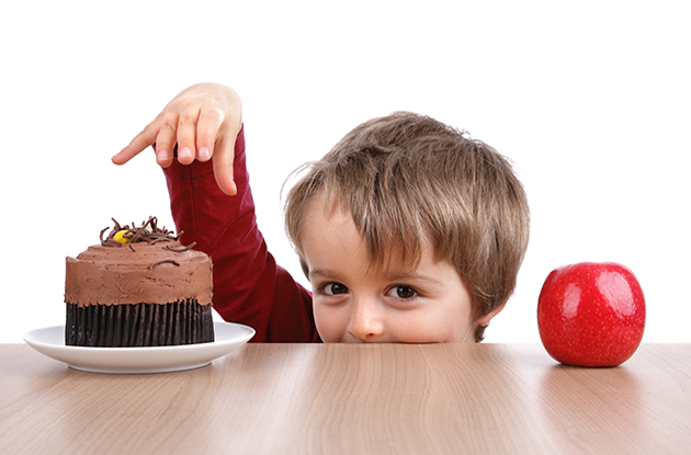 child making choice between two foods