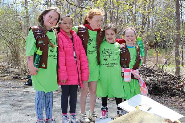 Girl Scouts picking up litter