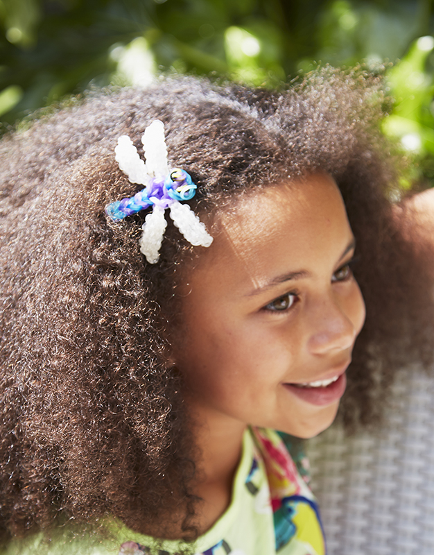 girl wearing rainbow loom dragonfly hair accessory
