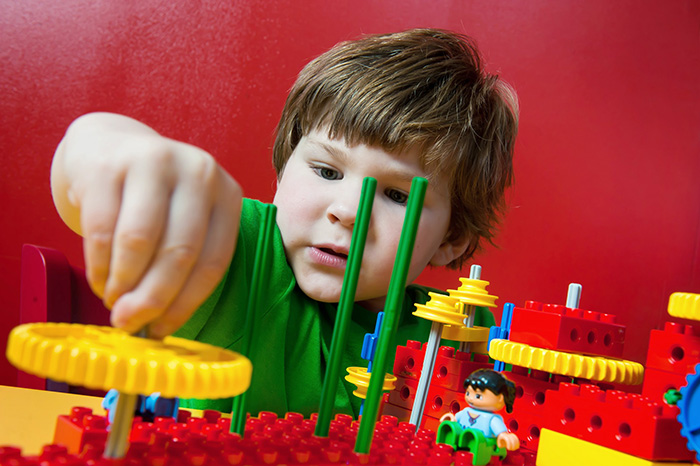 boy building with legos