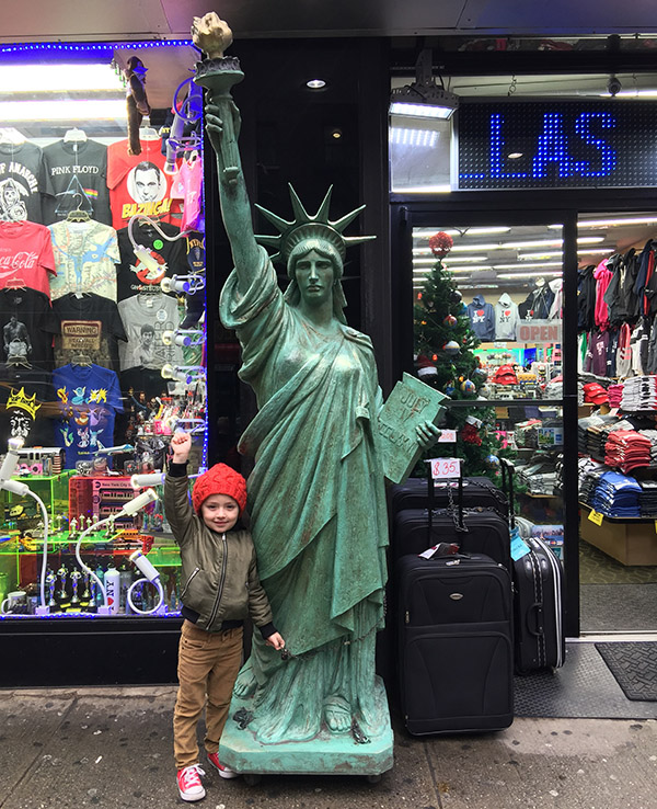 kid with statue of liberty