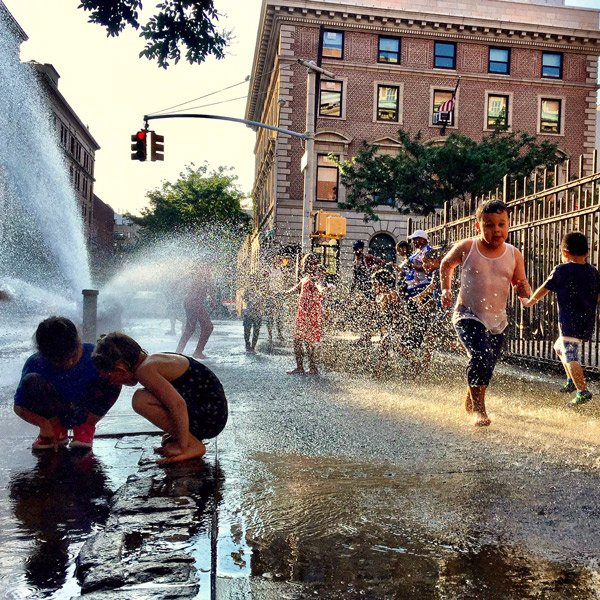 kids playing in hydrant fountain