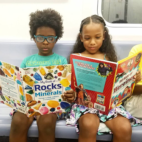 kids reading on the subway
