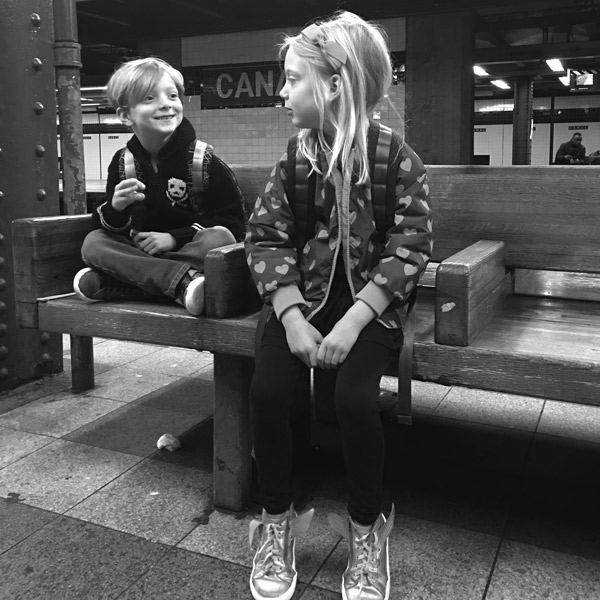 kids sitting in subway station