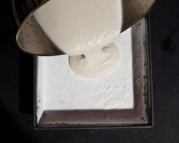 pouring marshmallow mix in pan