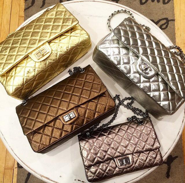 An assortment of metallic purses on sale at A Second Chance Designer Resale.